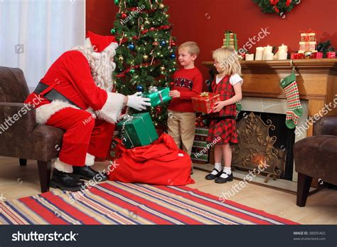 santa claus gives christmas gifts children stock photo