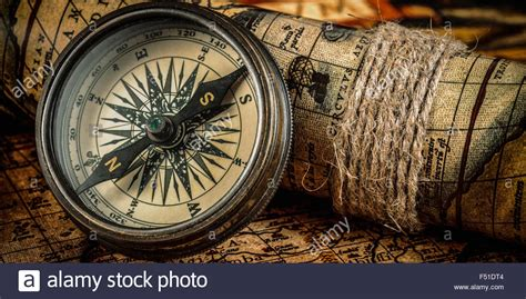 old vintage images old vintage compass on ancient map stock photo royalty