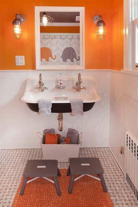grey and orange bathroom orange and gray boy s bathroom features top half of walls