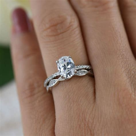 1 25 ctw oval deco swirl wedding set solitaire ring
