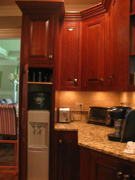 hidden water cooler storage traditional kitchen