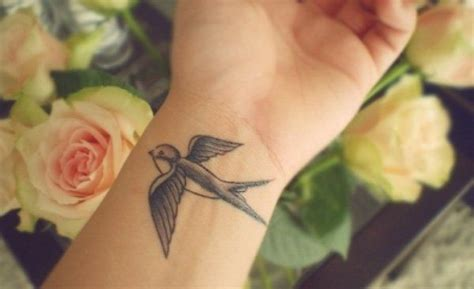 swallow tattoo meaning on wrist best 25 meaning ideas on