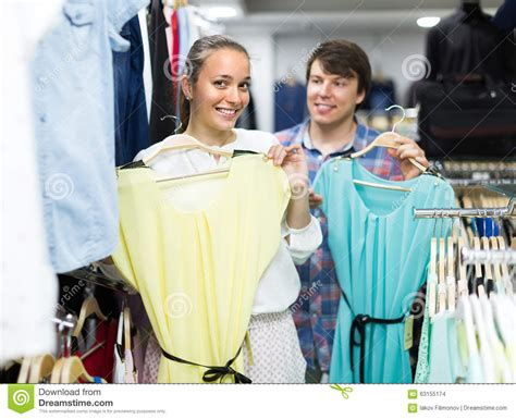Couples Clothing Store Doing Shopping At The Clothing Store Stock Photo