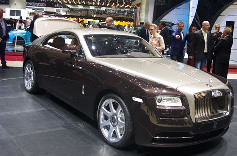 roll royce wraith rick ross money over bitches first with a wraith thug cry