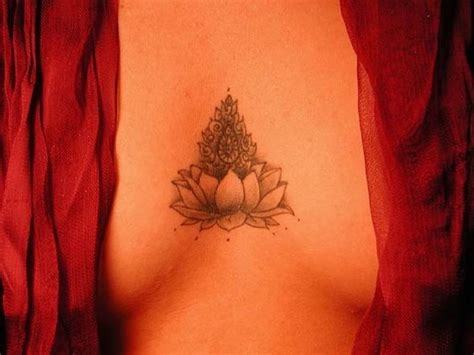 red lotus tattoo and body piercing a lotus to represent a new beginning or a hard time in