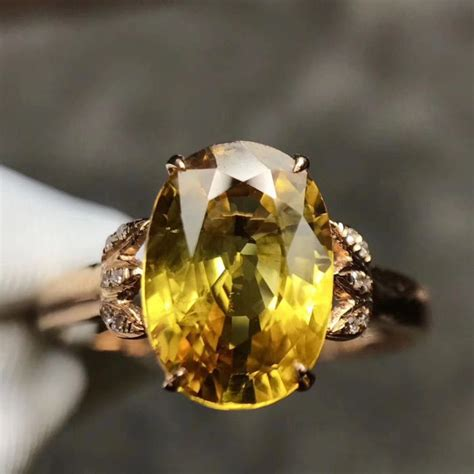 18kt yellow gold ring with fancy yellow sapphire 2 6ct