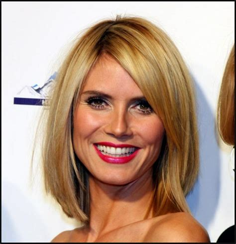 midlength jagged blunt cuts long angled bob hair style straight a little layered and