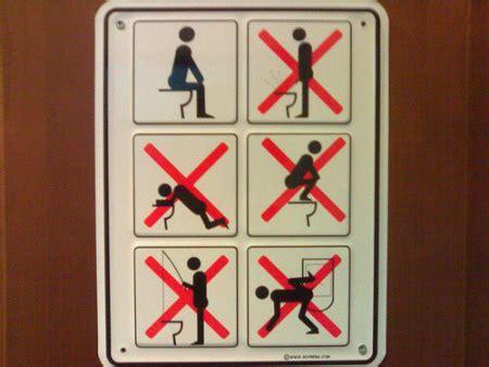 sochi bathroom sign dope message board