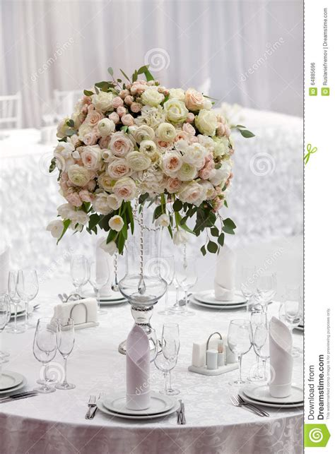flowers on table table setting at a luxury wedding reception beautiful