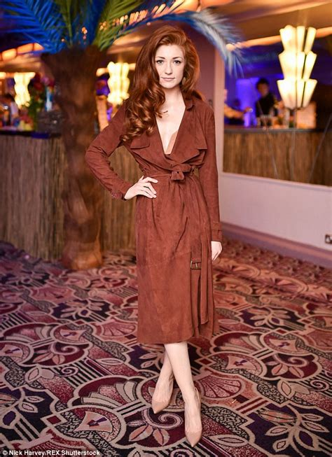 Nicola Roberts in plunging belted coat as she attends ... Nicola Roberts Fashion