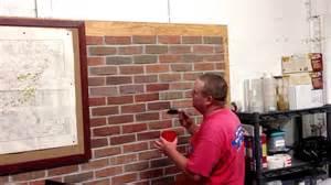 applying stain to brick