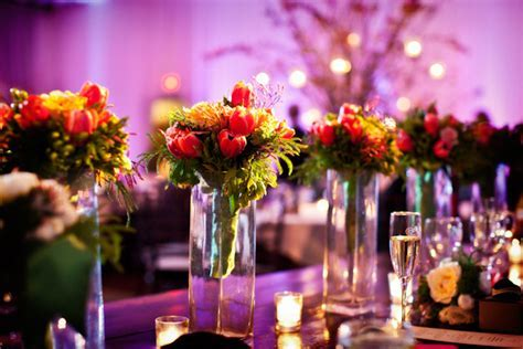 centerpieces on reception seating tables of dark pink