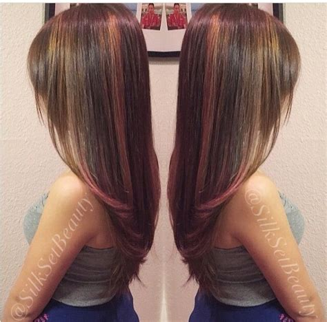 highlight foil layouts balayage brunette with whispy feathered layered haircut