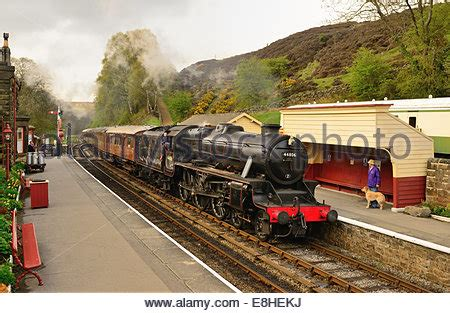 train arriving at the north yorkshire moors railway