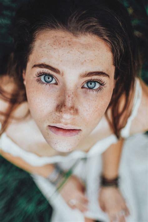 brown hair light skin blue uneven light skin freckles black eyelashes
