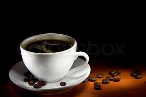 coffee dark wallpaper cup of coffee and beans on black background stock photo