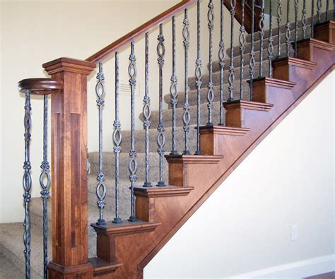 Wood railing with wrought iron balusters traditional staircase salt lake city by titan
