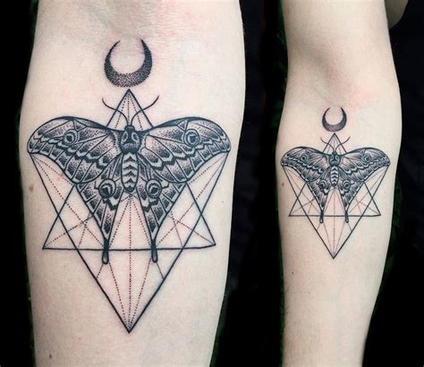 black ink geometric insect tattoo on forearm