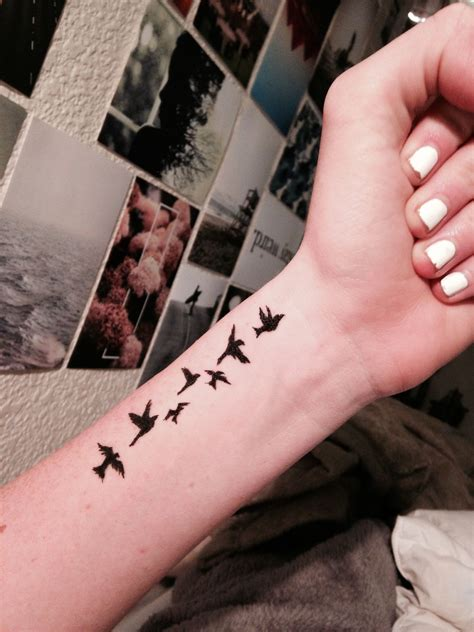 flying birds tattoo on wrist birds wrist typical tat