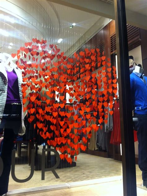 valentines day window displays paper use paper flowers on a hula hoop and hang from