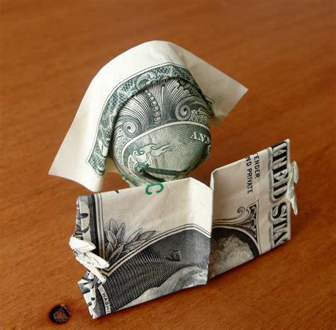 Dollar Bill Origami Book - dollar origami reading by craigfoldsfives on deviantart