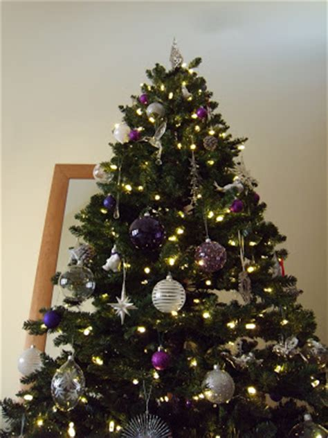white and purple decorated christmas tree