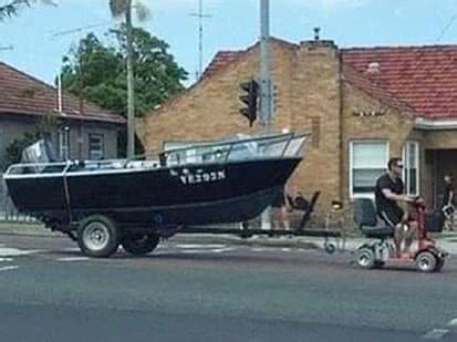 tow boat mobility scooter a newcastle man has been charged for towing his boat with