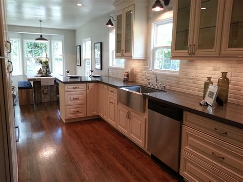 oak cabinets with white countertops antique white kitchen antique white cabinets jeffrey