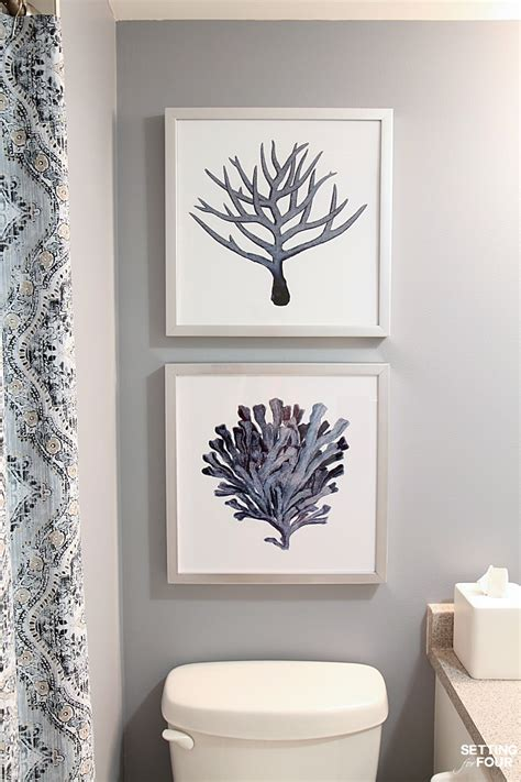 to hang pictures on wall height measurements and how to hang pictures in a bathroom