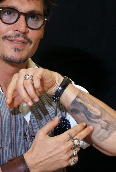 johnny tattoo pictures johnny depp showing a tattoo of a photograph of his mother
