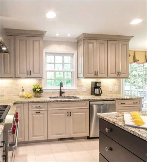 crown paint for kitchen cupboards use molding to upgrade your taupe kitchen cabinets love the dark stain color on the