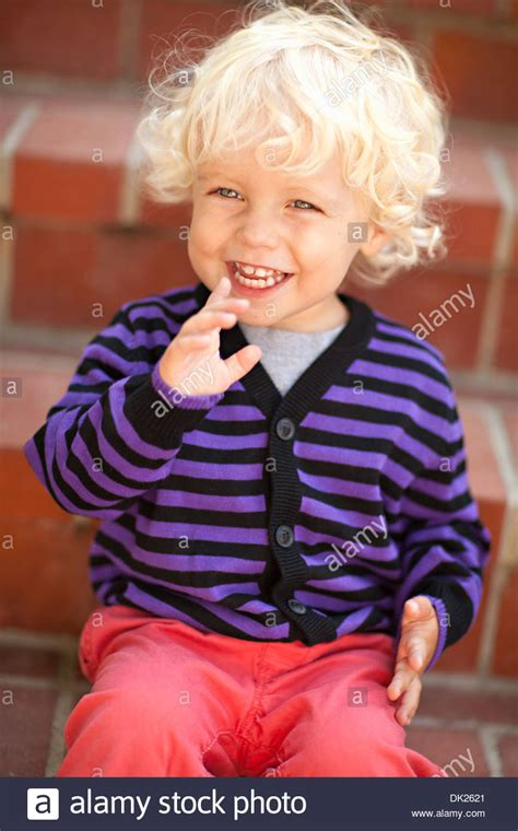 two year ol boys with curly hair close up of tilt blonde toddler boy with curly hair