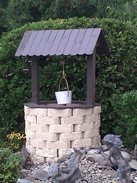 Garden Well by Wishing Well Made With Recycled Fencing And Garden Border