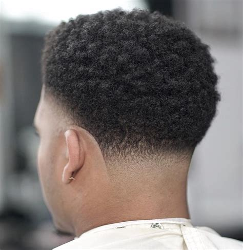 black men haircut hair ob top faded on sides and in back fade haircuts for black men