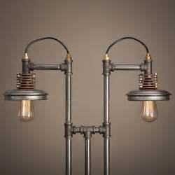 Unique industrial iron pipe furniture in the shape of lamps suspension