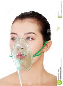 Diseased Female Patient Wearing A Oxygen Mask Royalty Free Stock
