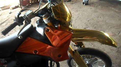 spray painting motorcycle spray on chrome dirt bike 1