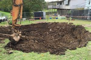 backyard sinkhole ipswich sinkhole being filled in property owners to