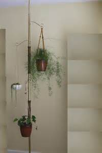 vintage tension pole hanging plant stand