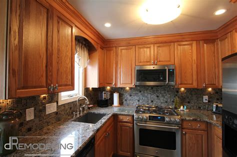 oak cabinets  mosaic backsplash traditional kitchen philadelphia  dremodeling