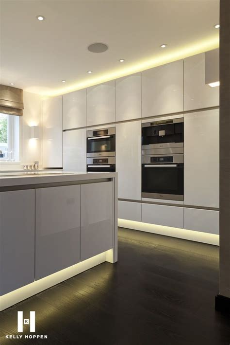 glamorous lighting all white kitchen with floor to