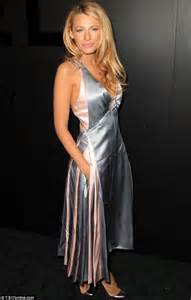 Blake Lively takes the plunge in metal strap gown at first