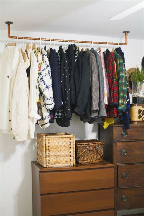 Small Bedroom Ideas hanging copper pipe clothing rack diy a beautiful mess