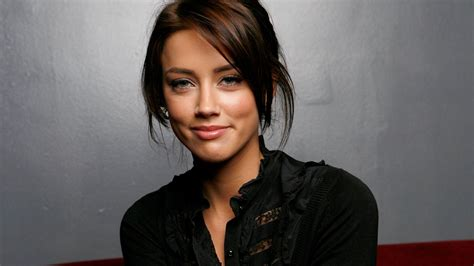 who is the brunette actress in the by viagra commercial amber heard chooses roles not dependent on how she looks