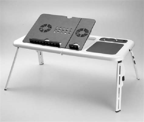 a cool desk with notebook computer cooling fan by sanwa