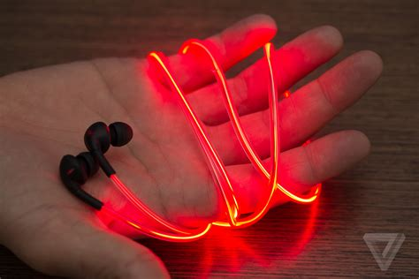 Glow Headphone up with glow s laser light earbuds the verge