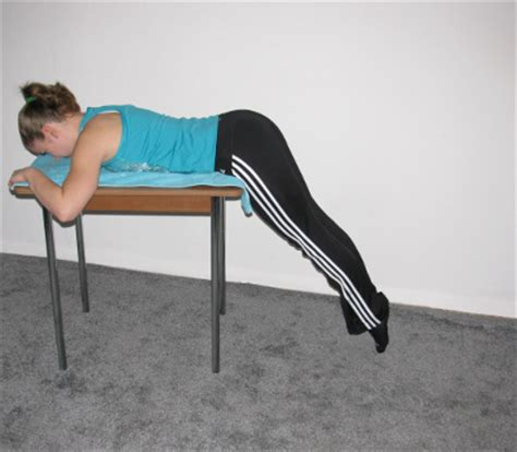hyperextension without bench reverse hyperextension on table form muscles worked benefits