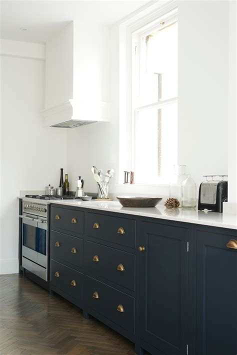 dark blue kitchen cabinets pantry blue and parquet a perfect match the devol