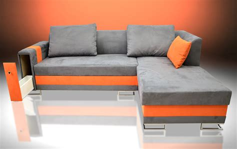 corner sofa bed with drawer in the armrest faux