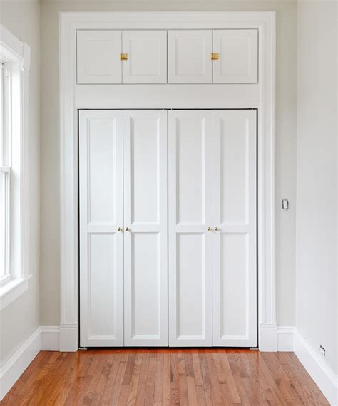 Adding Trim To Bifold Closet Doors - how we added hunky trim to our bi fold doors